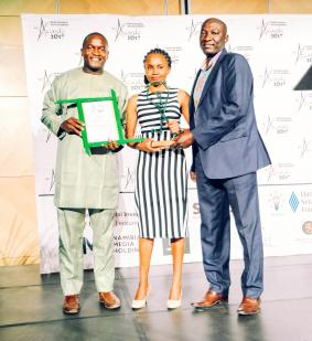 Mr. Sioni Iikela (r) with representatives from Young Achievers which won the best Youth for Sustainable Development category.