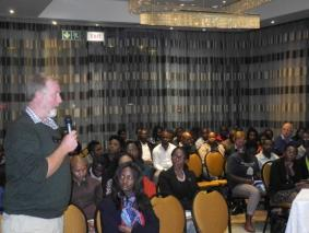 Dr. Chris Brown makes his point during the public lecture